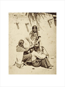 Hopi woman dressing hair