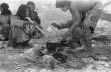 Wilfred Thesiger's party preparing food. ...