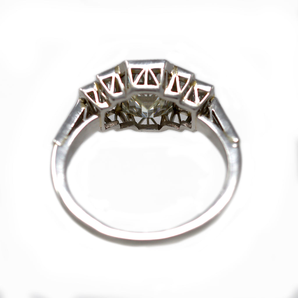 An Elegant Emerald-cut Diamond Ring with side baguettes set in Platinum back view