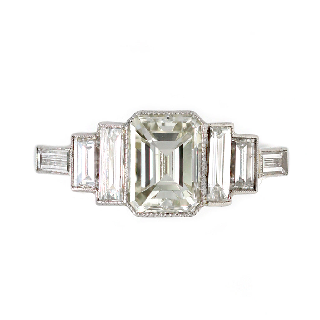 An Elegant Emerald-cut Diamond Ring with side baguettes set in Platinum top view