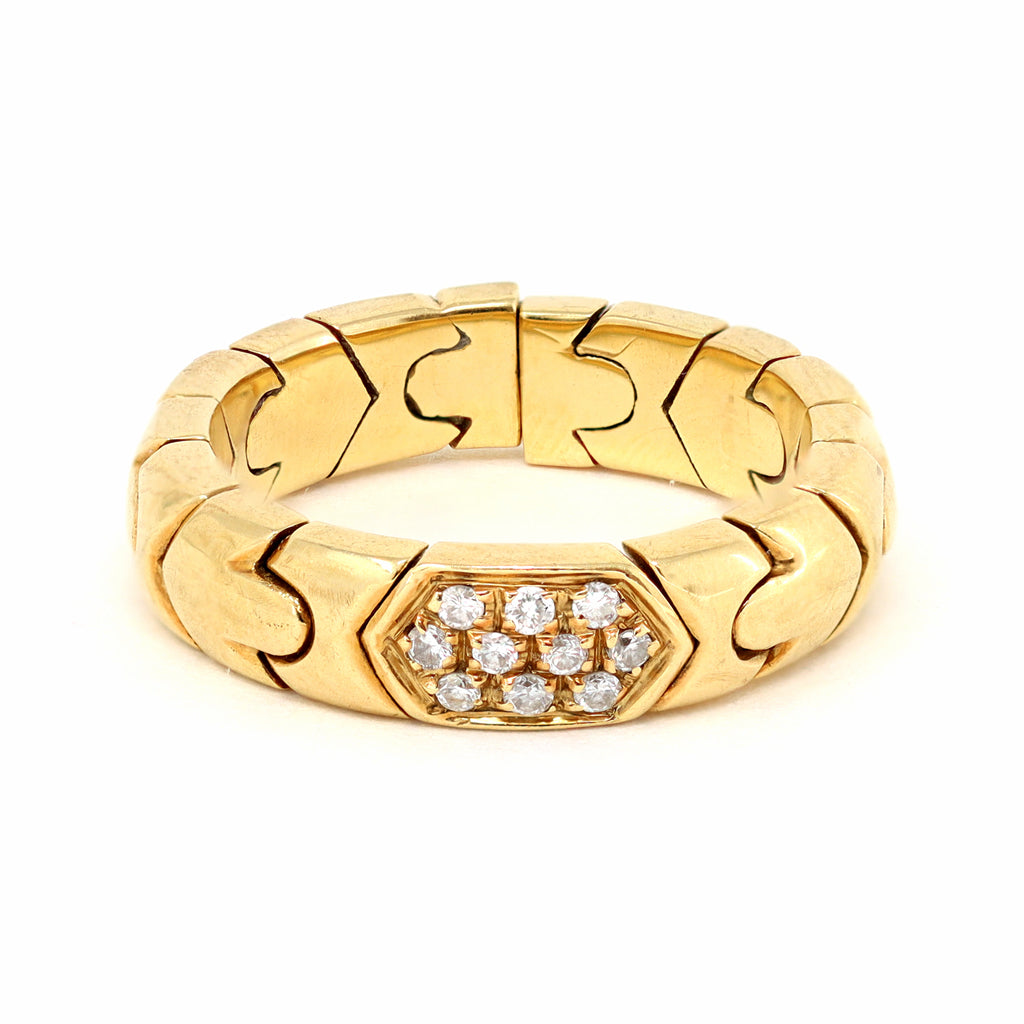 Signed Bvlgari Parentesi Diamond Band Ring in 18 Karat Yellow Gold, circa 1980 front view