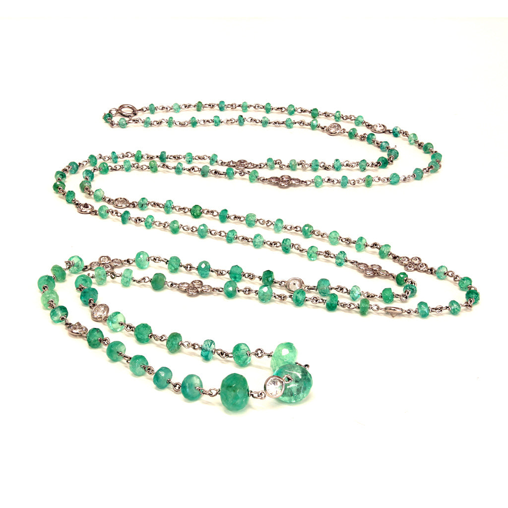 Long Platinum Faceted Natural Emerald Beads and Diamonds Necklace curved view