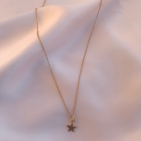 Gold Star Necklace displayed on a white background