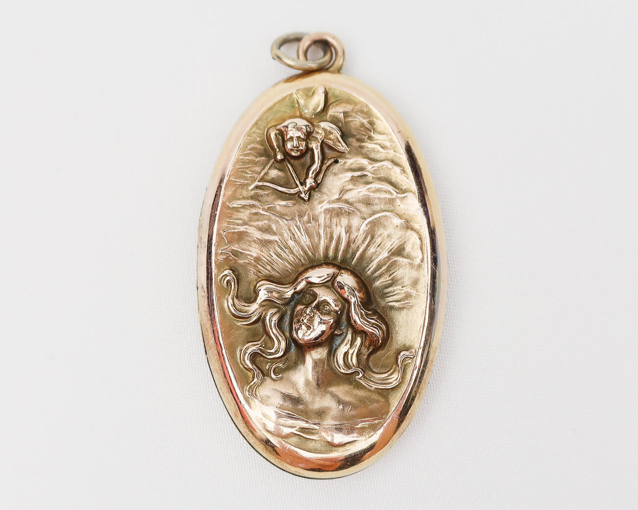 Art Nouveau Gold Oval Locket with Woman & Cupid