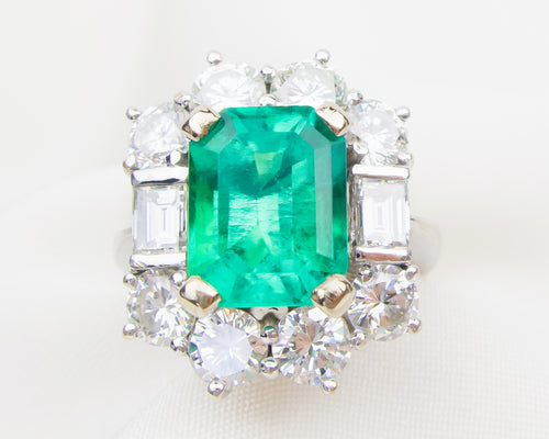 Circa 1970 Columbian Emerald & Diamond Halo Ring