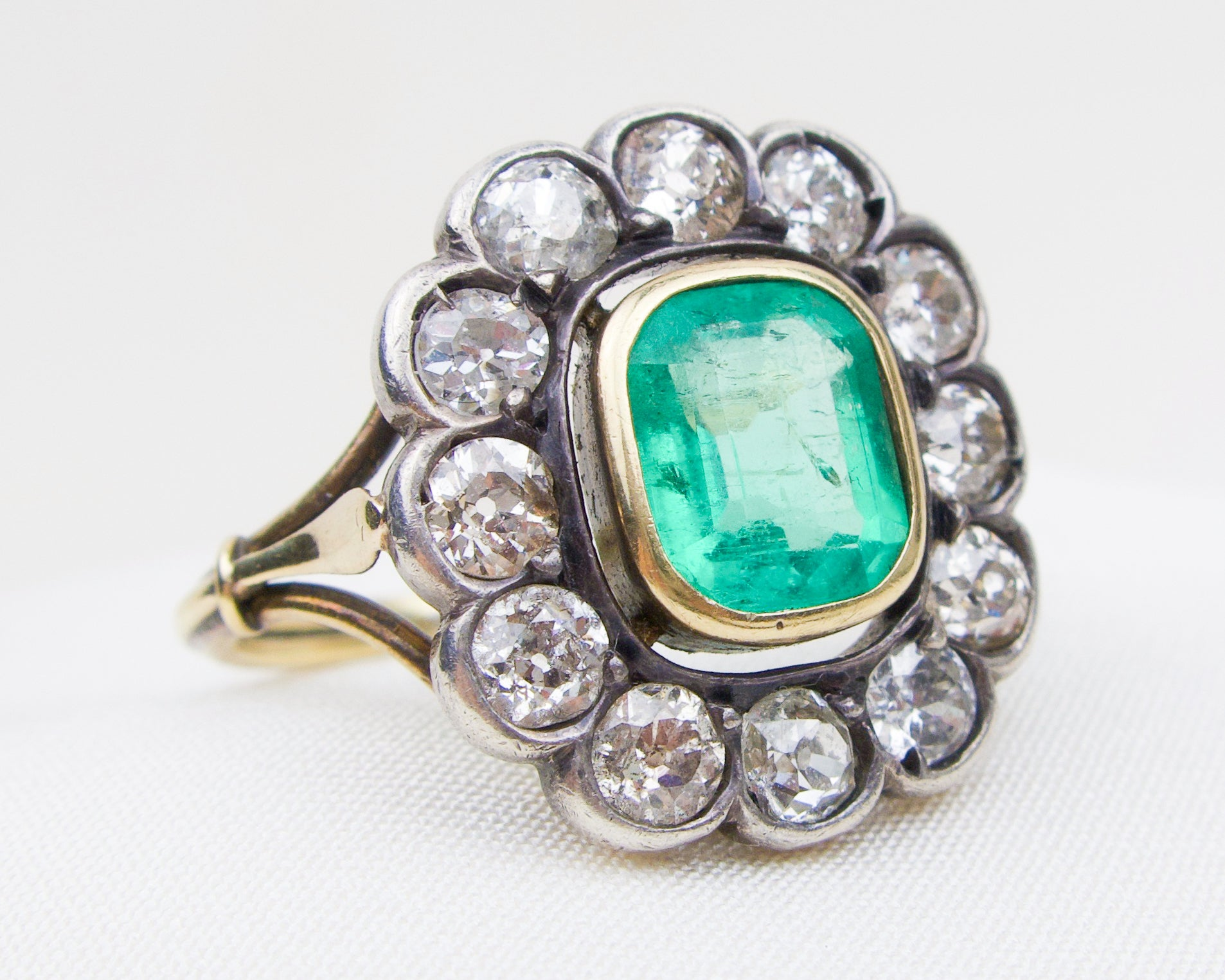 c. 1900 Emerald and Diamond Halo Ring