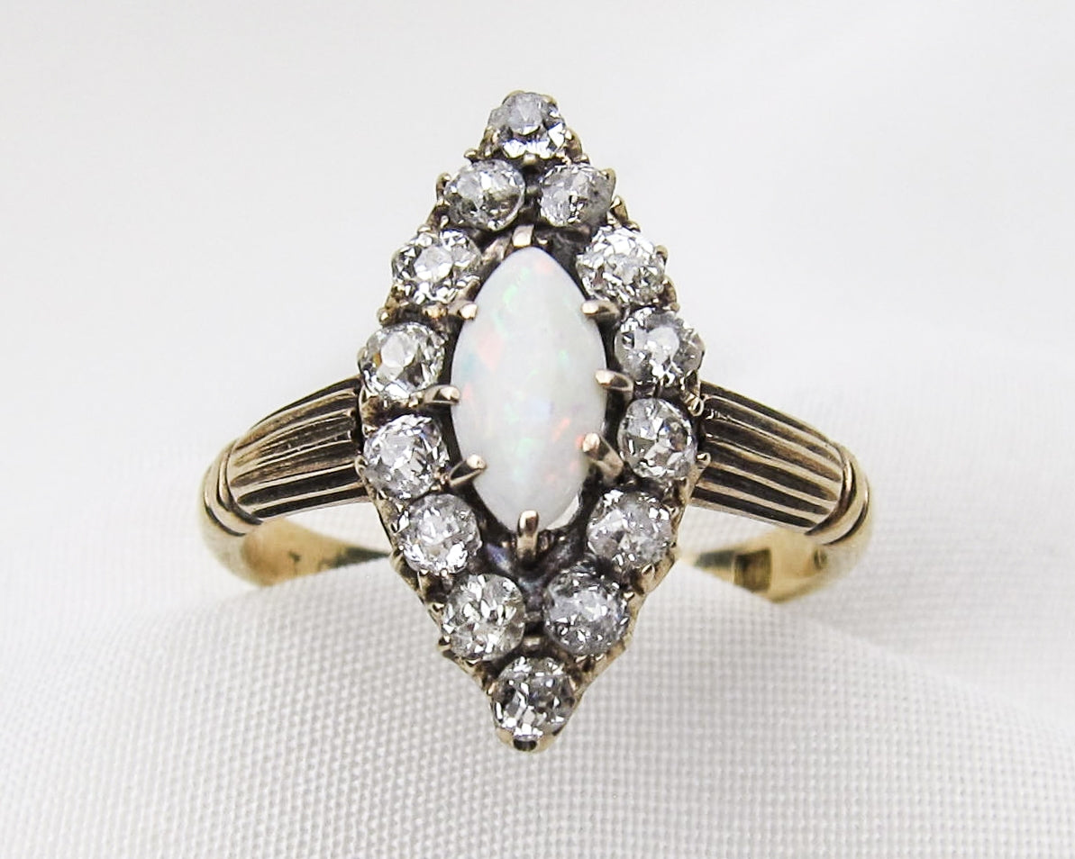 opal-diamond-gold-navette-ring