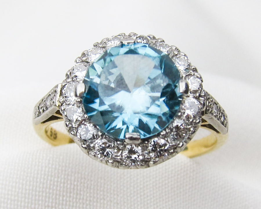 art-deco-blue-zircon-diamond-halo-ring