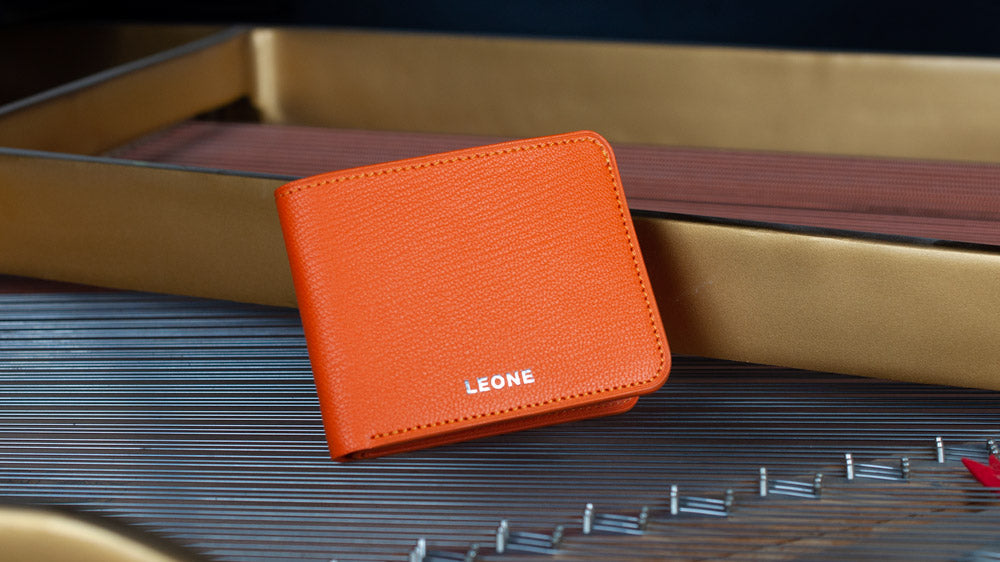 LEONE Leathercraft Tangerine Wallet Stylized on Piano