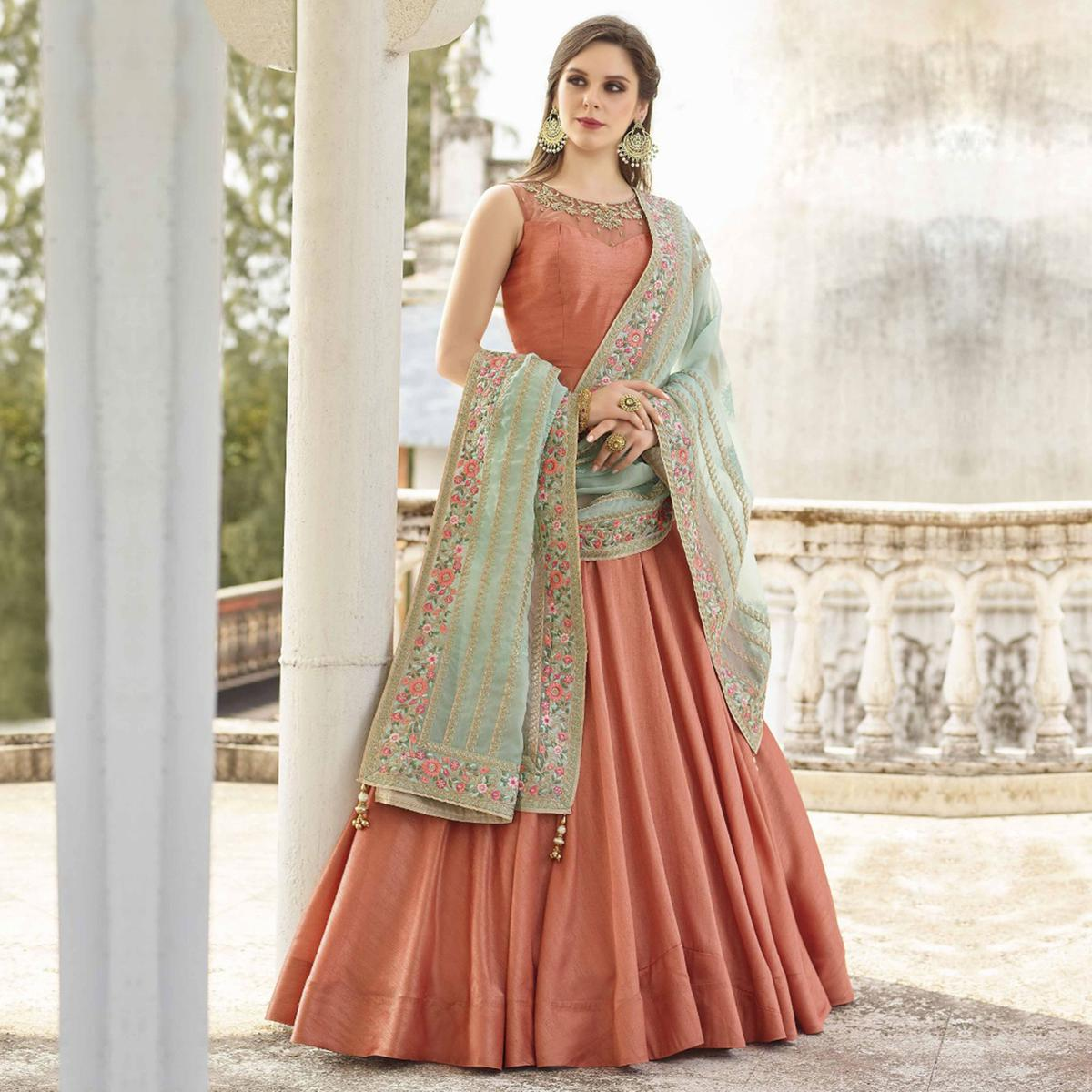 Entrancing Rose Gold Colored Partywear Embroidered Banglori Silk Gown