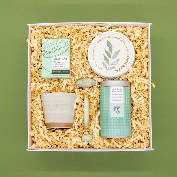 white luxury gift box with green tea basil and mandarin body butter jade face roller and organic soap