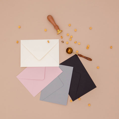 luxurious envelopes and wax and stamp on a beige backgound
