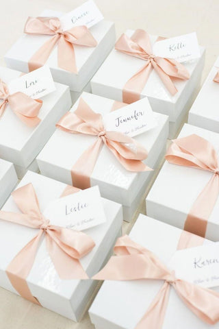 white gift boxes with pink ribbon