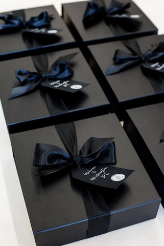 black luxury gift boxes with black ribbon