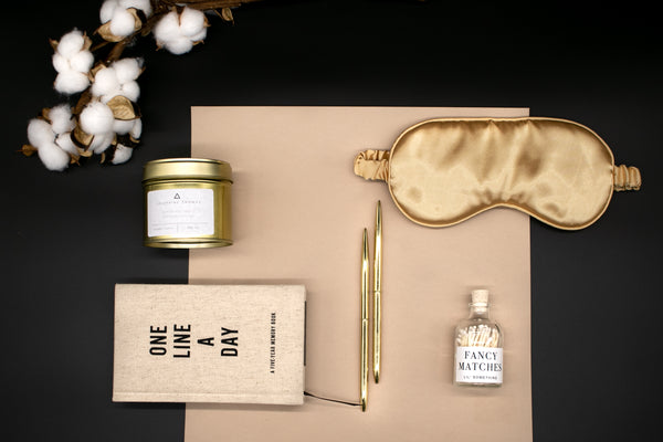 self care gift box for a better sleep routine with a sleep mask journal and a lavender candle