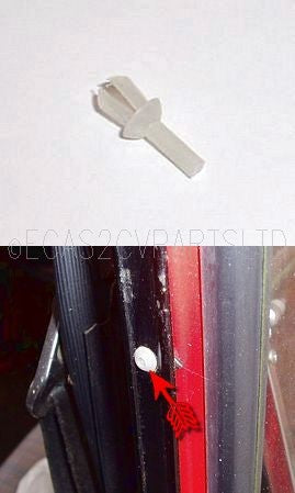 Plastic rivet clip, holds rear door hinge cover to door. Each