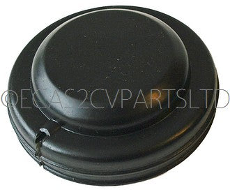 Rear suspension arm bearing plastic dust cover cap with cut out for brake pipe.