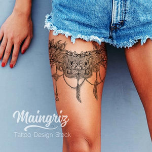 feather and pearl lace garter tattoo design