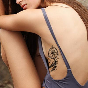 dreamcatcher sideboob tattoo design