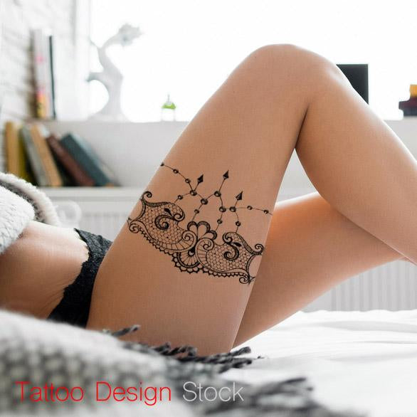 lace garter and pearl tattoo design