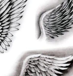 realistic wings tattoo design created by tattoodesignstock.com