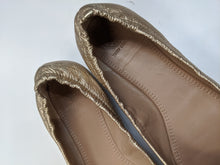 Load image into Gallery viewer, Tory Burch Gold Flats Size 9