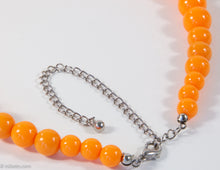 Load image into Gallery viewer, VINTAGE ORANGE PLASTIC GRADUATED BEADS NECKLACE/ NEW OLD STOCK
