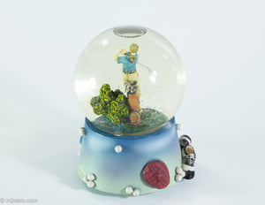 MUSICAL GOLF GLASS SNOW GLOBE OF LADY GOLFER WATER FILLED COLORFUL SPARKLES PLAYS 'TOP OF THE WORLD'