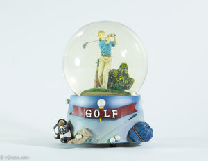 MUSICAL GOLF GLASS SNOW GLOBE OF LADY GOLFER WATER FILLED COLORFUL SPARKLE PIECES | PLAYS 'TOP OF THE WORLD'