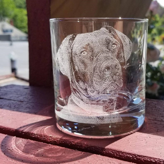 laser etched dog on a cup