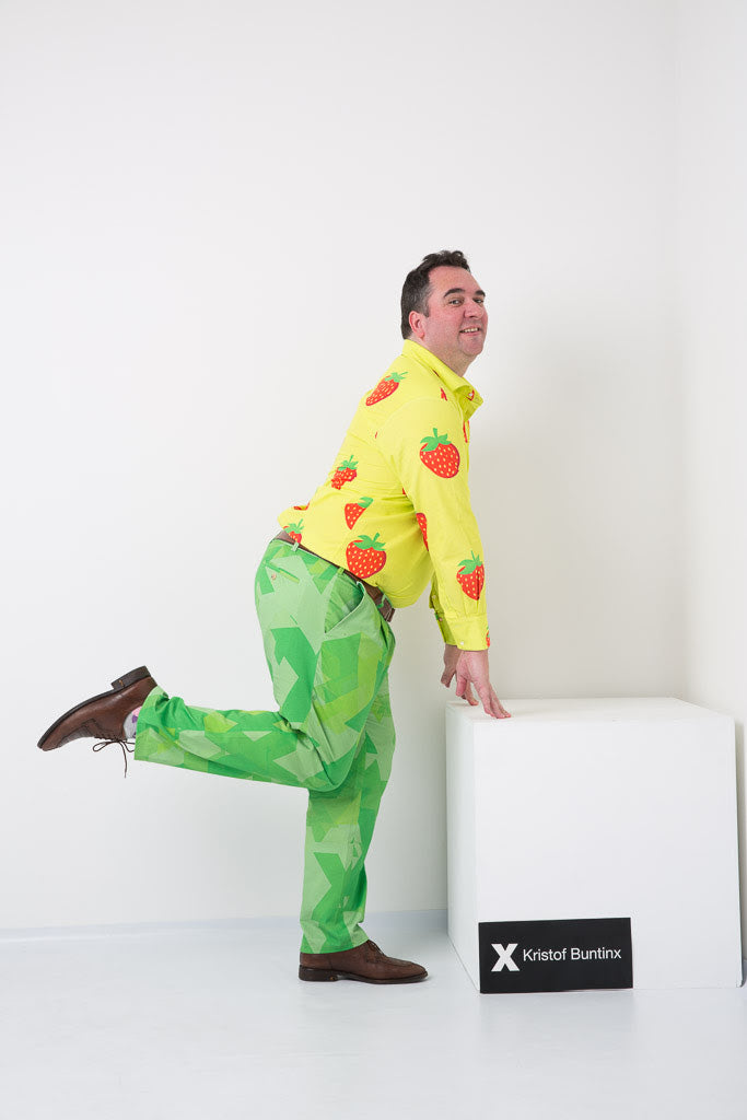 Kristof Buntinx wearing a strawberry shirt and green trousers