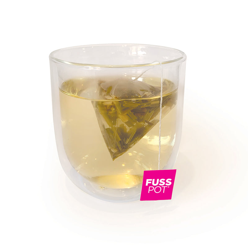 Fusspot Collagen Beauty Tea, a beauty tea with hydrolyzed collagen peptides as a beauty tea to support skin, hair and nails, anti-ageing, reduce wrinkles. Hot pink packaging. Beauty Product. Beauty Tea with collagen peptides, Herbal Tea. lemongrass & ginger herbal tea.. biodegradable compostable enviro-friendly teabags. soilon pyramid teabags. in clear tea cup