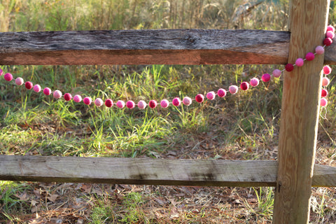 Our lovely Felt Pink Pompom Garland is handmade in Nepal of 100% wool. It's needle felted, and 3D designed. The garland is about 4' long. It looks great from any angle.