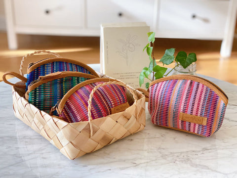 This conchoidal coin purse is a wonderful fusion of traditional weaving with modern style. It is handmade ethically by a social enterprise called WOVEN in Nepal. The coin purse is made with handwoven cotton fabric with a real suede leather base and trim. - Ganapati Art & Craft Gift Shop