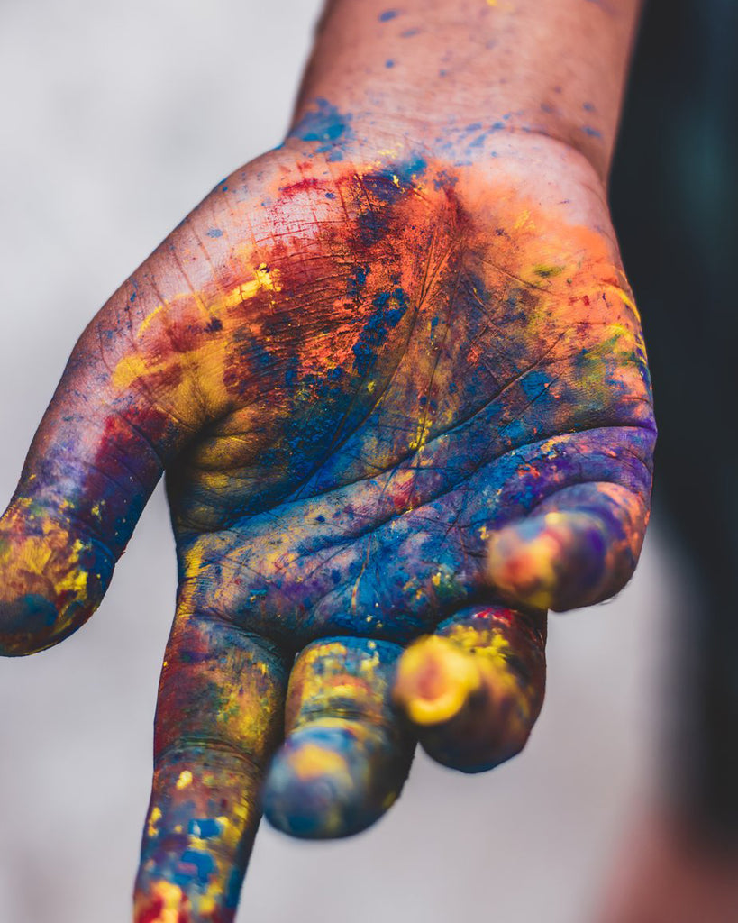 Hand covered in paint.