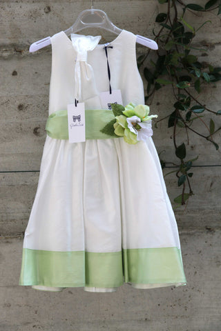 White cotton dress with green belt and hem
