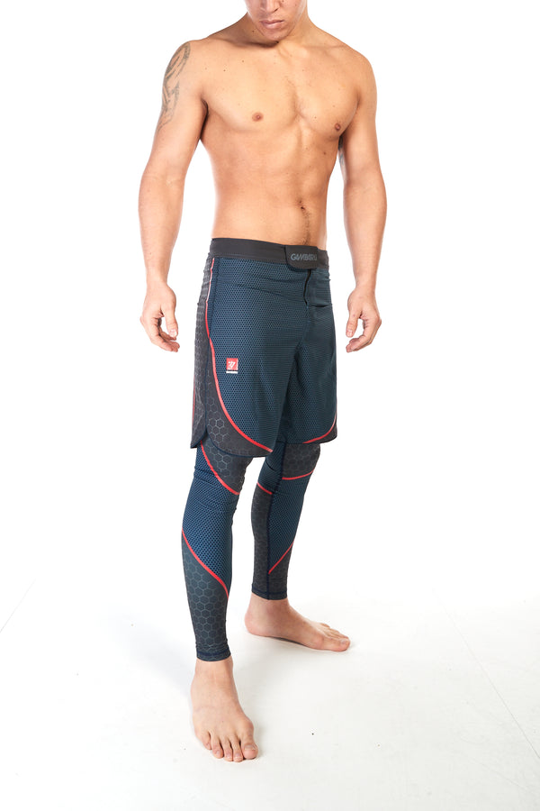 Man wearing training shorts in blue pattern with red piping to shape the thigh