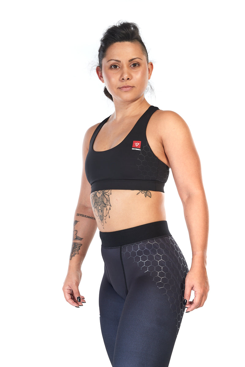 Woman wearing tight fit, racerback sports bra in black