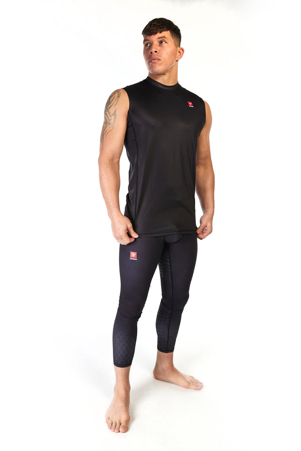 Man wearing unisex sleeveless training top in black with small red Gambaru Fightwear logo on the chest