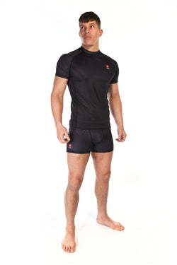 Man wearing unisex short sleeve training top in black with small red Gambaru Fightwear logo on the chest