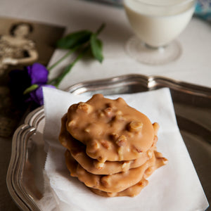 Plate of creamy style pecan pralines. Creamy pralines are softer and chewier.
