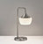 Brushed steel Table Lamp with a Frosted Glass Shade on a grey background  image 7
