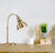 Live setting of the Antique Brass Metal Arc Style Desk Lamp