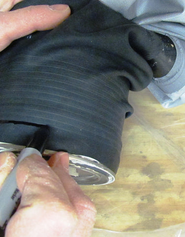 use a marking pen to highlight the trim ring on a drysuit gasket before cutting