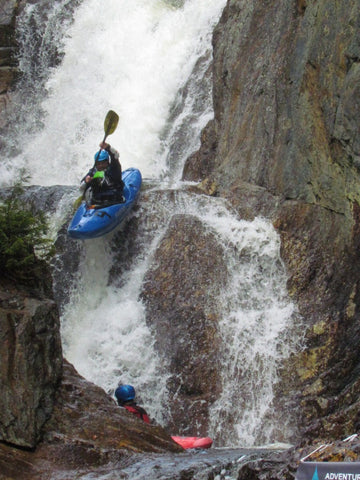 Kayaker on waterfall
