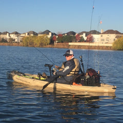 Kayak fishing in drysuit