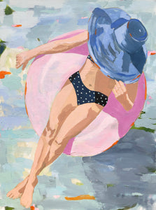 Kristin Cooney's fine art giclee print of a pretty woman in a bikini floating in an innertube in a beautiful water scene, has a feminine palm beach vibe and is the perfect art to add some fun and elegance any home decor, interior design.  Printed on Archival Matte Paper Metallic Bamboo frame or natural wood frame.
