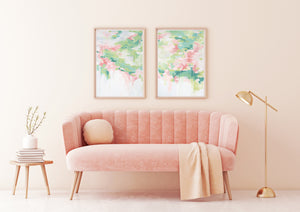 Kristin Cooney's pretty abstract art print set of Georgia Peach 1 and 2 has light and airy pink, peach, and greens with a sense of floral reflections on the surface of water. The white negative space encourages an air of lightness and calm. This pretty abstract art is elegant in any home decor, bedroom art.