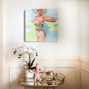 Kristin Cooney's fine art print from her Bathing Beauties collection, inspired by 1950's beach fashion and feminine charms. Woman in white vintage bikini and scarf, sitting at garden pool. Elegant nostalgic fashion art to add beauty to any home decor, interior design, beach house art, spa art, female figure art