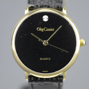 Elegant Oleg Cassini diamond gold plated case ladies wrist watch with black dial
